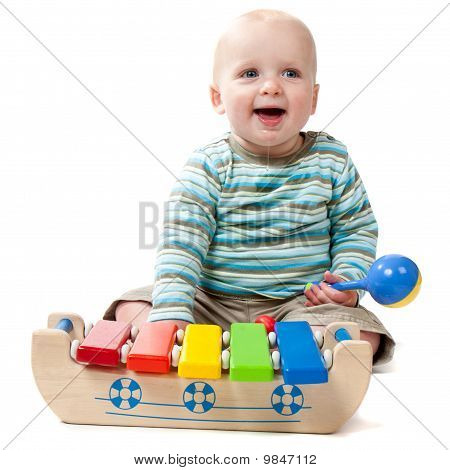Dribbling Baby Boy Playing With Xylophone