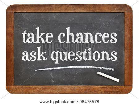 Take chances, ask questions - motivational advice on a vintage slate blackboard