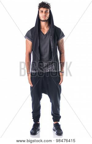 Full length shot of tough young man in dark t-shirt isolated
