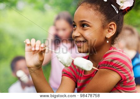 Portrait of African girl and marshmallow stick