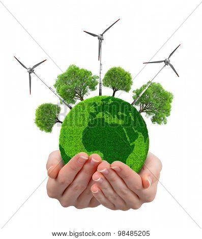 Green planet with trees and wind turbines in hands isolated on white background