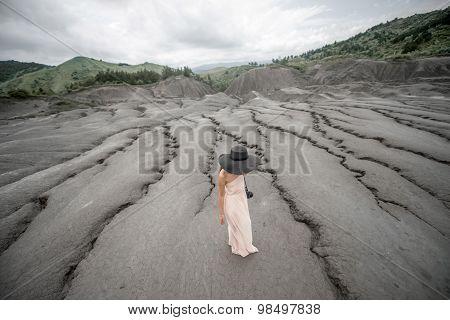 Female traveler near mud volcanoes