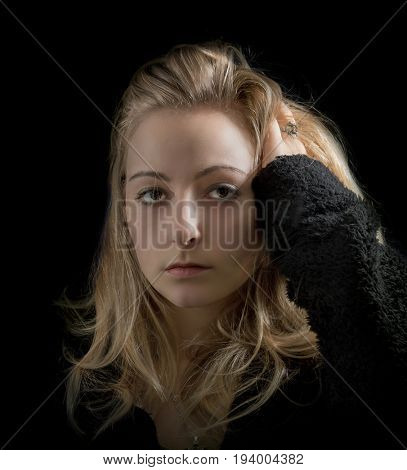 Portrait of  woman on black background.