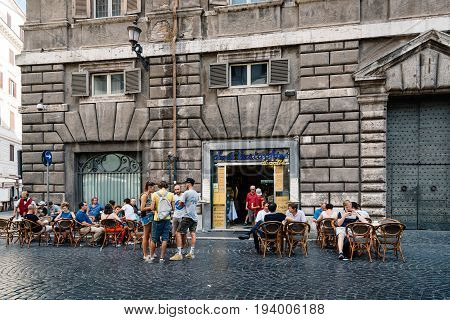 Rome Italy - August 18 2016: Sidewalk cafe with tourists in square in Rome a sunny summer day