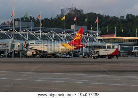 Sanya Hainan China April 25 2017 - Capital Airlines Airbus A-320 aircraft stands near the terminal of domestic airlines at Phoenix Airport