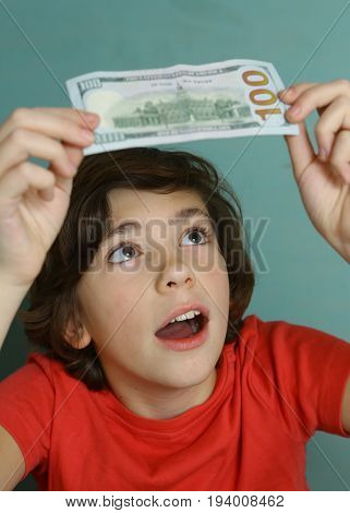 Teenager Boy With One Hundred Dollar Bill Look For Water Marks
