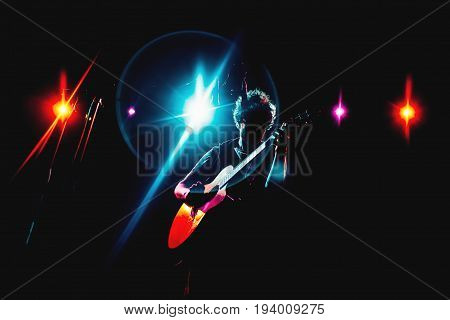 Guitarist silhouette on a stage in a colorful backlights