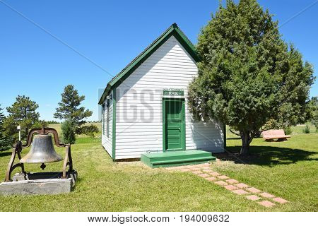 NEWCASTLE, WYOMING - JUNE 23, 2017: Anna Miller Museum School House. The main museum is housed in the Wyoming Army National Guard Cavalry Stable, the last calvary stable in Wyoming.