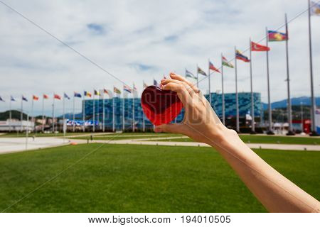 Sochi, Russia-june 18, 2017: The Girl Holds A Heart In Front Of The Ice Palace