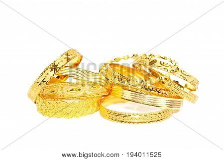 Golden bracelets , isolated on a white background
