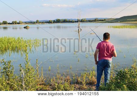 Pictures of people trying to fish in the lake
