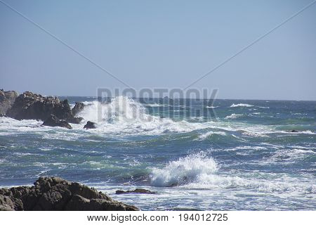 Waves Crash on Rocks  along 17 mile drive Pebble Beach California