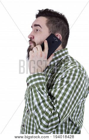 Young man with a beard speaks on a mobile phone
