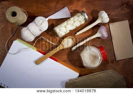Varied garlic package on a wooden background