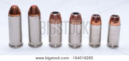 Six bullets, 44spl, 40 caliber, 9mm lined up on a white background