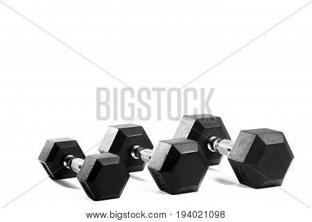 Three black metal dumbbells on isolated background