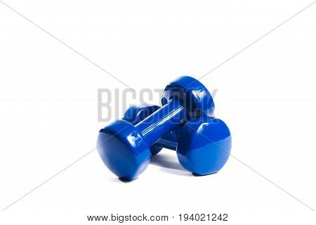 Two blue dumbbells on an isolated background In a random order