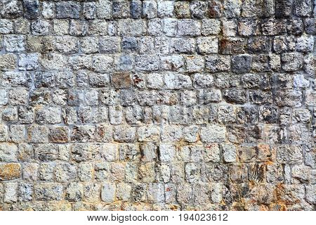 Texture of old fortified stone wall, architecture background