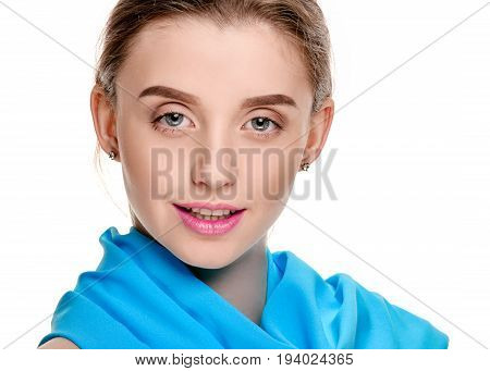 Close up portrait of attractive female model with blue scarf