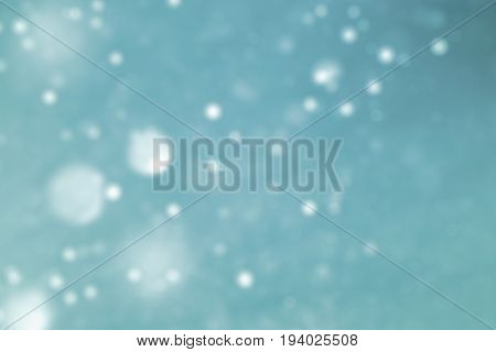 luxury blue glittering light background for copy space concept. light blue glowing glittering lights abstract bokeh background. golden rain defocus lighting image