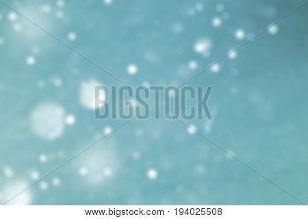luxury blue glittering light background for copy space concept. light blue glowing glittering lights abstract bokeh background. golden rain defocus lighting image