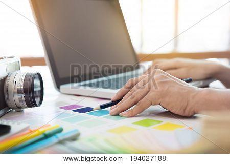 Interior Design And Renovation And Technology Concept - Graphic Designer Choosing Proper Color Sampl