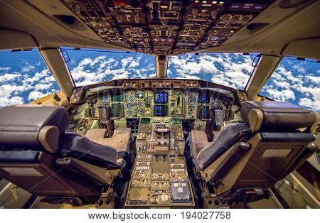 Aircraft Cockpit empty with clouds in windows