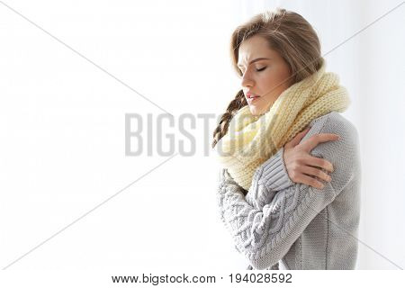 Young ill woman at home