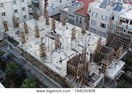Antalya, Turkey - May 26 2017: Turkish builders are building monolithic multi-storey building, preparing the form - molding to pouring concrete