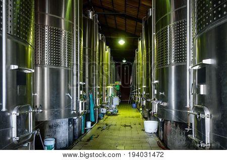 Metal Wine Barrels In A Winery