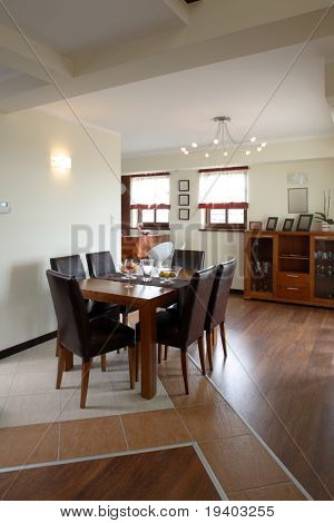 A view of an open dining room and kitchen