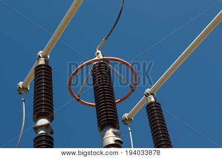 Red and brown high voltage isolation with ceramic body on blue sky