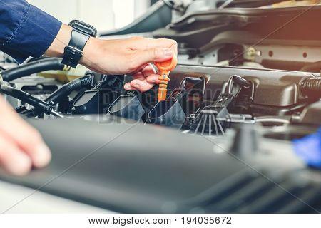 Mechanic Changing Oil Mechanic In Auto Repair Service.