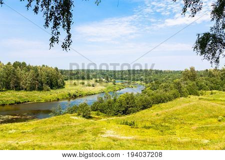 Landscape with river, forest, sky and clouds