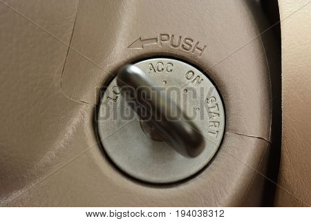 Car key in lock position at keyhole