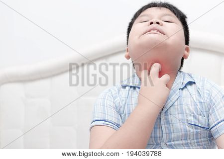 Asian Obese Boy Scratch The Itch With Hand On Bed