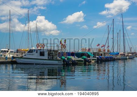 Labuan,Malaysia-May 1,2017:Yachts & boats in the yacht club at Labuan Public Marina near the Waterfront Hotel in Labuan Pearl of Borneo,Malaysia.