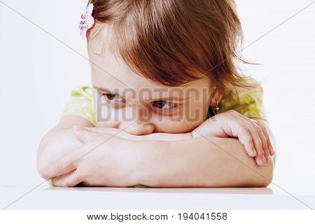 Portrait of a sad and lonely little girl alone with her problems. (Childhood anxiety fear insult experiencing a concept)