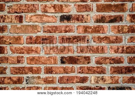 Grunge red brick wall background with copy space texture pattern. Old texture of red stone blocks closeup free space