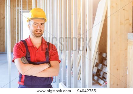 Portrait Of Smiling Worker On Building Site Background