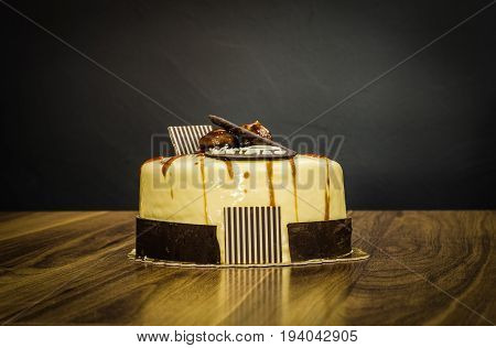Delicious Creamy Whole White Chocolate Cake With Chestnuts On Top On Dark Background