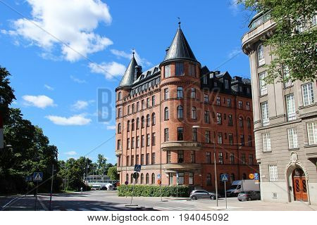 Stockholm, Sweden- 27 Jun 2017: view of the street with a classic Swedish homes, Scandinavian style of red brick and grey stone, the cars are parked on the street, the center of the capital.