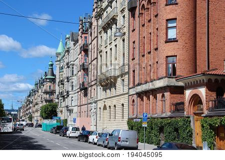 Stockholm, Sweden- 27 Jun 2017: view of the street with a classic Swedish homes, Scandinavian style of red brick and yellow plaster, the cars are parked on the street, the center of the capital.