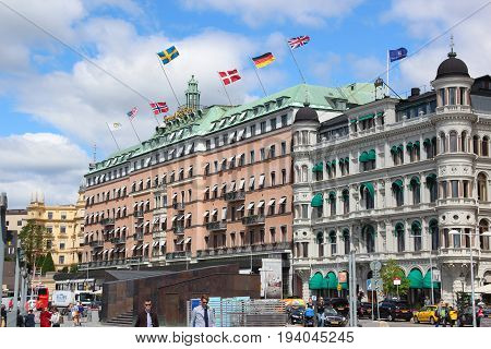 Stockholm, Sweden- 27 Jun 2017: View to the building of the Grand Hotel Stockholm with flags of different countries (USA, Finland, Norway, Sweden, Denmark, Germany, Great Britain) on the roof