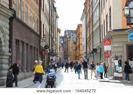 Stockholm, Sweden- 27 Jun 2017: The long Vasterlanggatan the central shopping street of Gamla Stan  old town centre of the scandinavian city