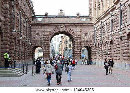 Stockholm, Sweden- 27 Jun 2017: Drottninggatan street and Arch of parliament in Gamla Stan, the oldest part of Stockholm in a summer day