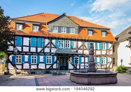 Fountain and half-timbered house in the old town of Grunberg. Hesse Germany