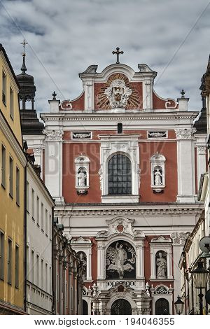 street and facade of baroque Catholic Church in Poznan