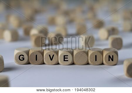 Give In - Cube With Letters, Sign With Wooden Cubes