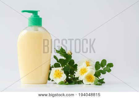 liquid soap with florist flowers on white
